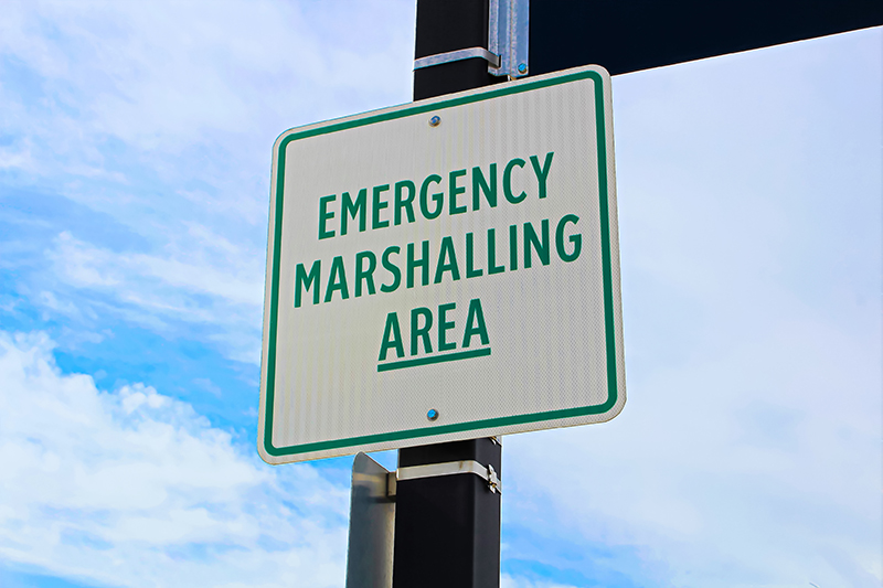 Emergency marshalling area sign on a street pole