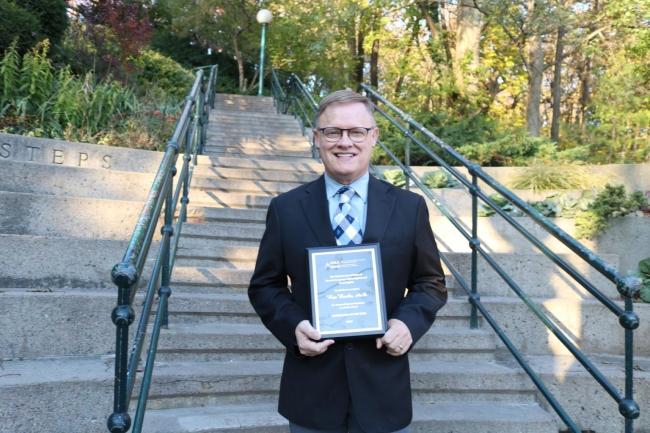 Rex Banks with award