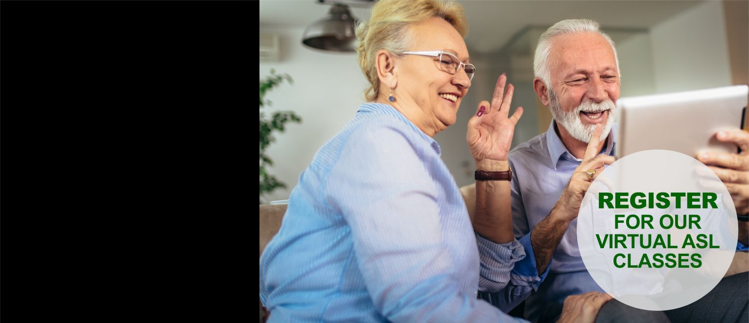 Older woman and man using sign language on a tablet