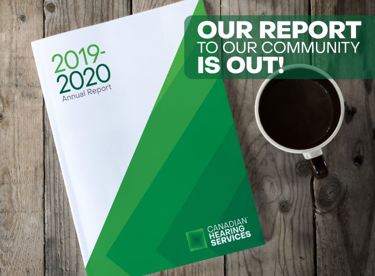 CHS 2019-2020 Annual Report cover on wooden desk next to coffee cup