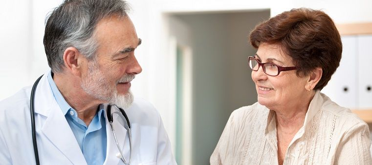 doctor communicating with older female patient