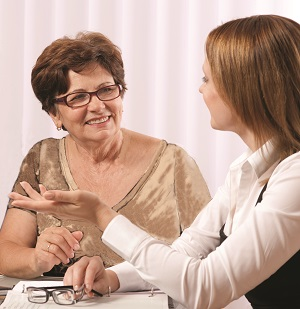 Hearing Care Counsellor speaks with an older woman.